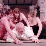 Ladies Man- George The Chef, Derek Thompson Is Wrestled To The Ground By The Ladies. L/R Jenni Rushton As Jacqueline, Sarah Warner As Suzette And Jane Douglas As Suzanne. Ian Mitchell, Who Plays Host Bernard, Is In The Background