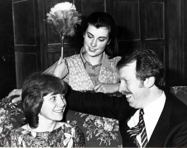 Beth Barton (Jane Dickens)listens in as John Danby (Steve Baxter) and Susan Wagstaffe (Sylvia Heaney) talk on the sofa.