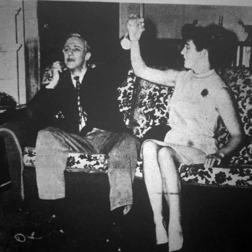 Holding Hands With Lady Fitzadam And Describing Over The Phone The Size Of A Fish He Has Just Caught Is Larry Hoffman (Ron Ellwood)