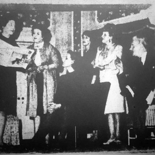 Checking A Radio Item Are Beatrice (Gwen Waite), Miss Hatfield (Mary McGuckin), Miss Parry (Virginia Roy), Maid (Dorothy Powers), Lady Alice (Barbara Hunter) And The Brigadier (John Gale)